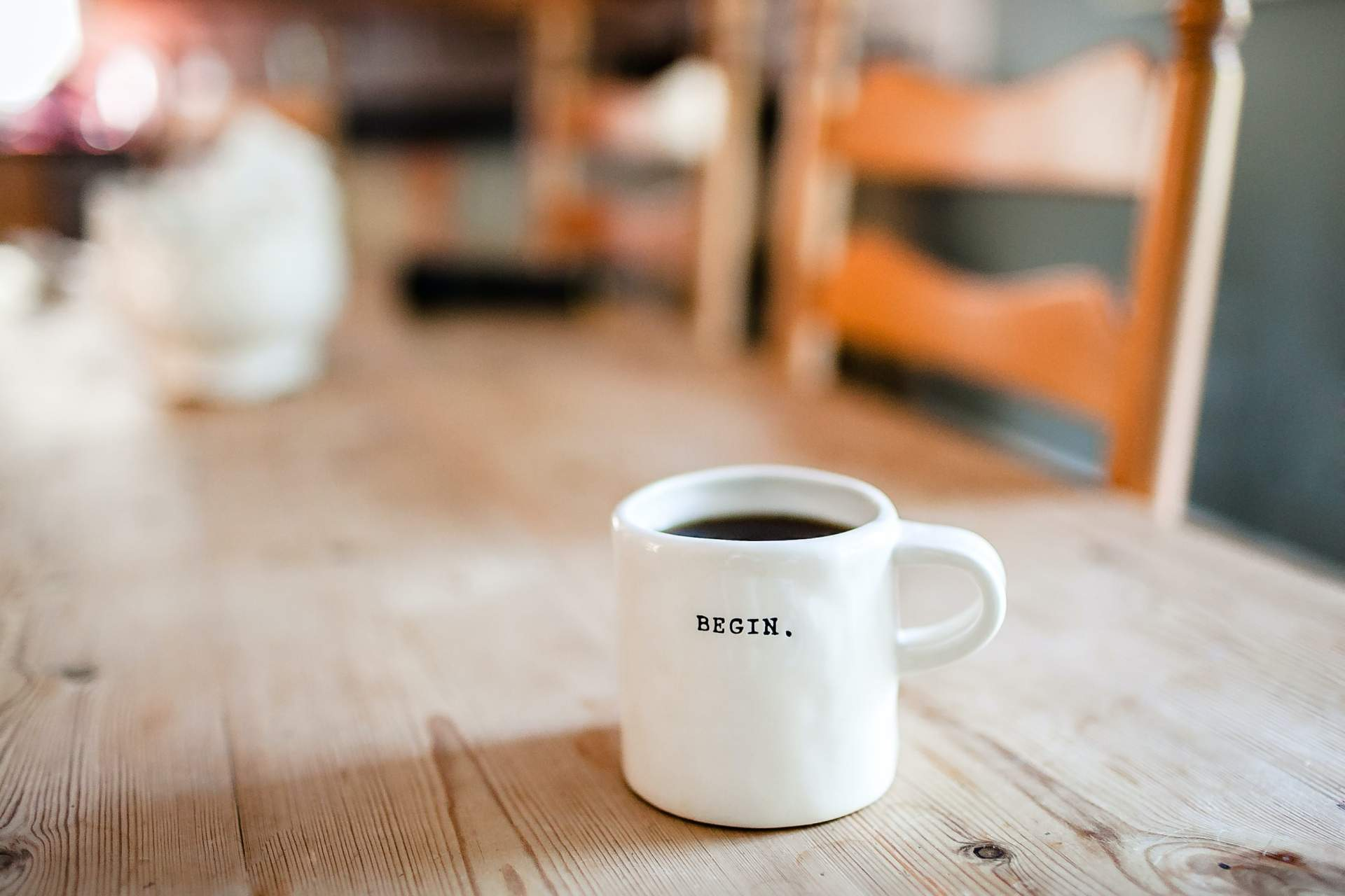 coffee cup that says Begin